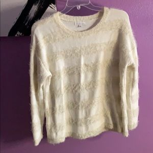 Cream colored sweater with a bit of fuzzies